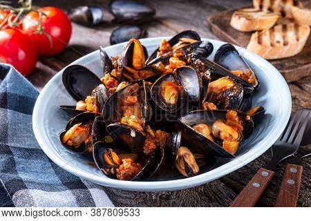Delicious Cajun Style Mussels Jambalaya With Sausage, Celery, Onion, Pepper And Tomato On A Rustic T