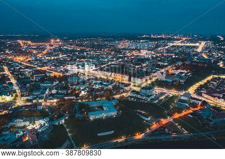 Grodno, Belarus. Night Aerial View Of Hrodna Cityscape Skyline. Famous Historic Landmarks In Lightni