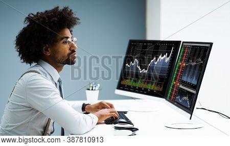 Stock Exchange Analyst Using Multiple Computer Screens