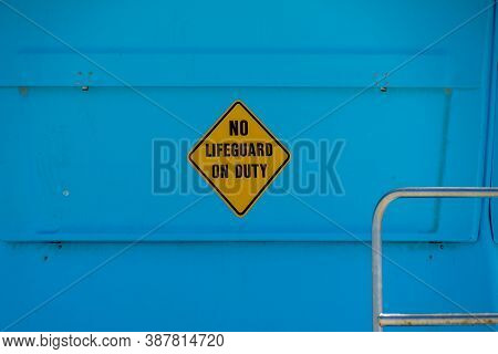Sign Saying No Lifeguard On Duty, At Lifeguard Tower On The Beach, California, Usa