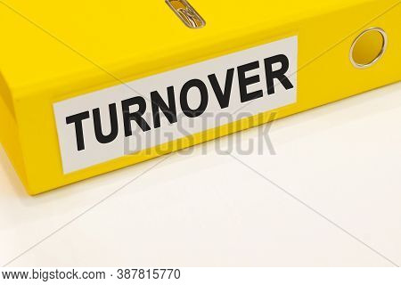 The Word Turnover On A White Background With A Yellow Folder. Business Concept