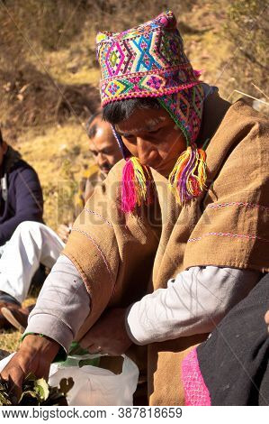 Sacred Valley, Peru- August 31, 2011: Portrait Of A Man Dressed With Traditional Clothes Making A Ri