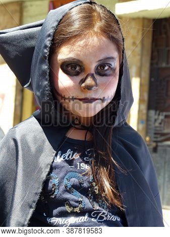 Cuenca, Ecuador - May 18, 2019: Close Up Portrait Of Unidentified Zombie Girl Looking At Camera At Z