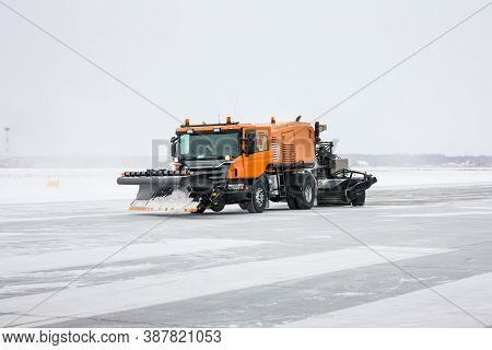 Snow Machine For Universal Cleaning On The Winter Airport Runway
