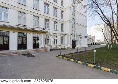 School Building With An Empty Courtyard. Classic Light Plastered School House In Moscow, A Typical B