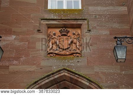 Scone, Great Britain - September 11, 2014: This Is An Old Family Coat Of Arms Over The Scone Palace
