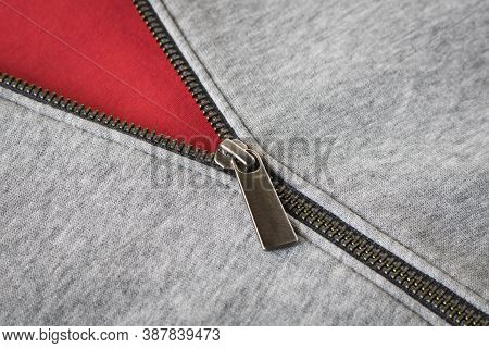Metal Zipper On The Sports Jacket. Close Up. Selective Focus