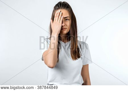 Young Woman In White T Shirt Covering With Hand Her Head, She Does Not Want To Listen News, Gossips,