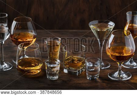 Strong Spirits Set. Hard Alcoholic Drinks In Glasses In Assortment: Vodka, Cognac, Tequila, Brandy A