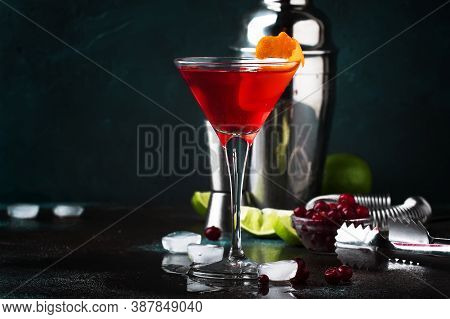 Classic Alcoholic Red Cocktail Cosmopolitan With Vodka, Liqueur, Cranberry Juice, Lime, Ice And Oran