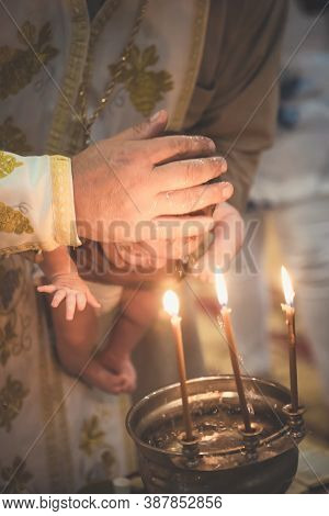 Orthodox Christian Rite Of Baptism Of A Child. Baptism Of The Child. Christianity. Bathing A Child.