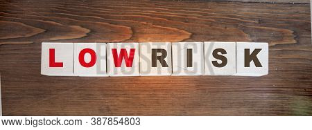 Low Risk Words Written On Wooden Cubes. Financial Risk Assessment, Risk Reward And Portfolio Risk Ma