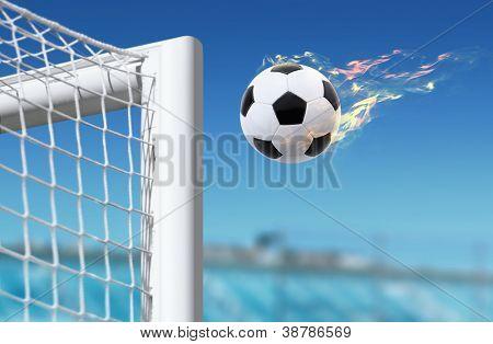fiery football flies in goalkeeper gate on stadium