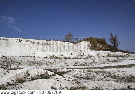 Cretaceous Mountain In The Ukraine, The Village Of Mogritsa. Chalk Mountains And Clear Blue Sky