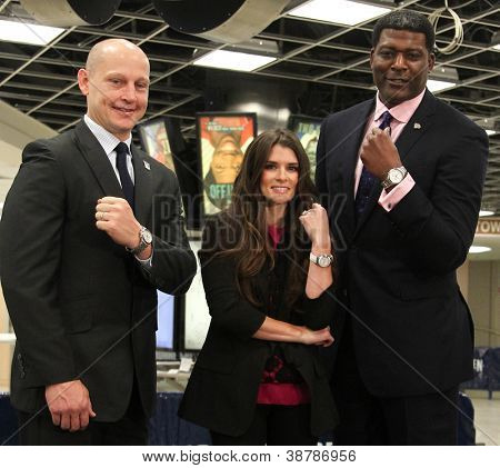 NEW YORK-OCT 25: Adam Graves, Danica Patrick and Larry Johnson attend unveiling of new Tissot Swiss Watches Lobby Clocks at Madison Square Garden Box Office on October 25, 2012 in New York City.