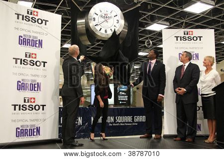 NEW YORK-OCT 25: Adam Graves, Danica Patrick and Larry Johnson unveil the new Tissot Swiss Watches Lobby Clocks at Madison Square Garden Box Office on October 25, 2012 in New York City.