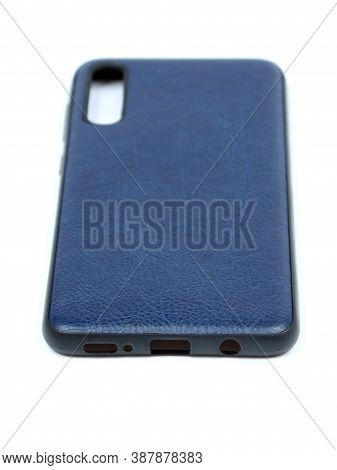 Moscow, Russia - February 22, 2020: Dark Blue Smartphone On A White Background In A Transparent Case