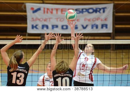 KAPOSVAR, HUNGARY - OCTOBER 7: Ildiko Szivos (R) in action at the Hungarian I. League volleyball game Kaposvar (white) vs Veszprem (black), october 7, 2012 in Kaposvar, Hungary.