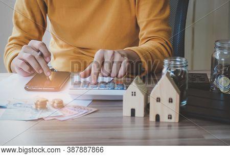 Young Beautiful Asian Woman Using Smartphone Calculator Calculate Loan In Home, Concept Finance Busi