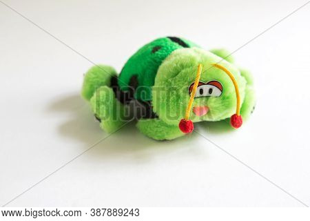 Soft Plush Toy For Children - Green Ladybug. A Beetle With Sad Eyes, Red Bells On Its Antennae, Unre