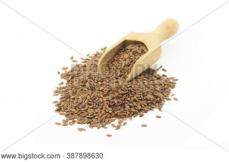 Heap Of Flax Seeds Or Linseeds In Wooden Scoop Isolated On White Background. Flaxseed Concept, Dieta