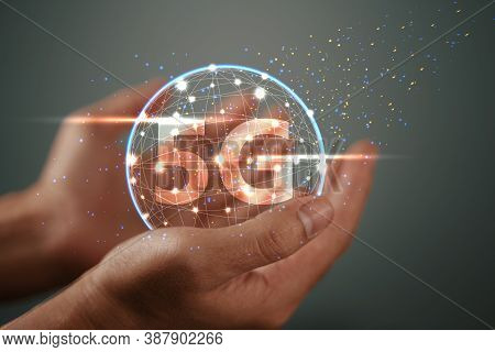 The Abstract Image Of Business Man Hold The 5g Hologram And Internet Of Things On His Hand