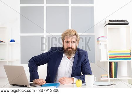 Confident Boss, Bossy Business Man. Successful Director Sitting In Office With A Laptop. Portrait Of