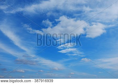 White Cirrus Clouds On A Background Of Dark Blue Sky. The Cloud Resembles A Flying Angel.