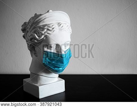 Plaster Copy Of The Head Of An Ancient Statue Of Diana On A Light Textured Background. Woman's Face