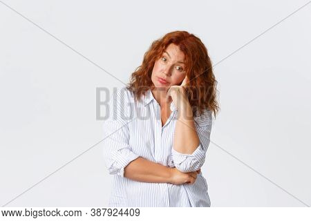 Annoyed And Bothered, Tired Middle-aged Lady With Red Hair Looking Exhausted And Fed Up, Leaning On