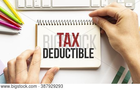 Businesman Hold Notepad With Text Tax Deductible White Background. Business