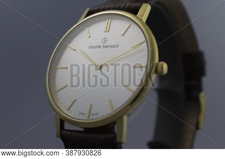 Geneve, Switzerland 01.10.2020 - Claude Bernard Swiss Made Watch Gold Pvd Coating White Dial Leather