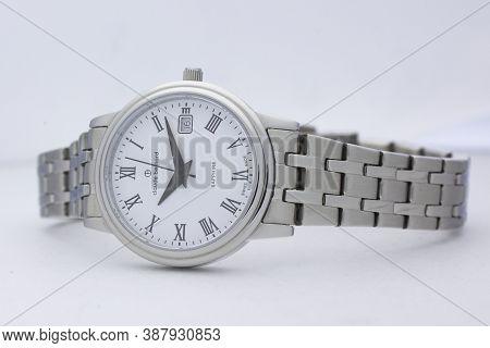 Geneve, Switzerland 01.10.2020 - Claude Bernard Woman Swiss Made Watch White Dial Metal Bracelet Iso