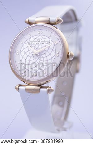 Geneve, Switzerland 01.10.2020 - Claude Bernard Swiss Made Watch Gold Pvd Coating Leather Strap Isol