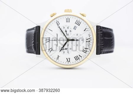 Geneve, Switzerland 01.10.2020 - Claude Bernard Man Swiss Made Watch Gold Pvd Coating White Dial Lea