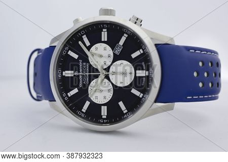 Geneve, Switzerland 01.10.2020 - Claude Bernard Man Swiss Made Watch Black Dial Blue Dial Isolated.