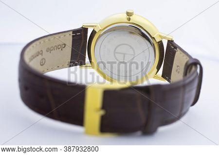Geneve, Switzerland 01.10.2020 - Claude Bernard Swiss Made Watch Gold Pvd Coating Back Case Leather