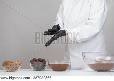 Chocolatier In White Uniform Step-by-step Making Hand-crafted Dark Chocolate Truffles, Preparing Del