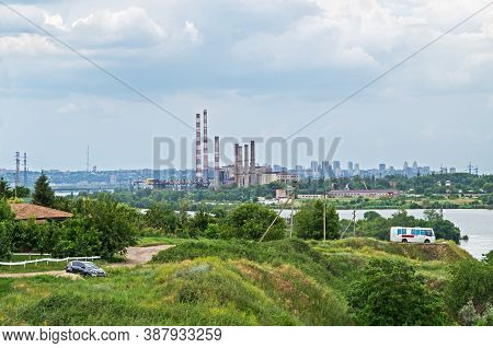Panoramic View From River Bank To The Outskirts Of City Where Thermal Power Station Is Located