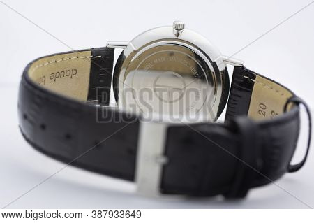 Geneve, Switzerland 01.10.2020 - Claude Bernard Swiss Made Watch Back Case Leather Strap Isolated. S