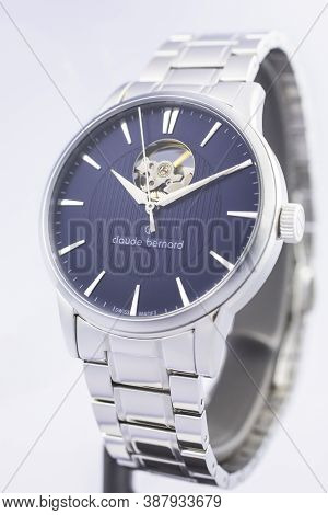 Geneve, Switzerland 01.10.2020 - Claude Bernard Man Swiss Made Mechanical Watch Blue Dial Metal Brac