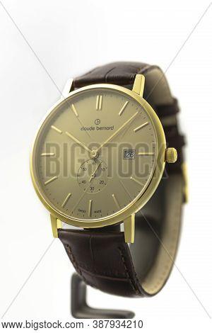 Geneve, Switzerland 01.10.2020 - Claude Bernard Man Swiss Made Watch Gold Pvd Coating Beige Dial Lea