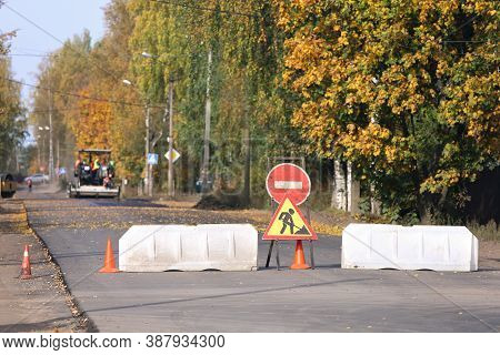 Plastic Road Barriers And Repair Work Signs Block Access To The Road Section Where Is Underway To La