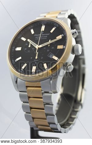 Geneve, Switzerland 01.10.2020 - Claude Bernard Man Swiss Made Watch Gold Pvd Coating Black Dial Met