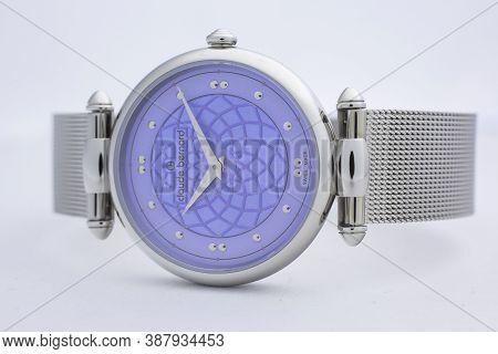 Geneve, Switzerland 01.10.2020 - Claude Bernard Woman Swiss Made Watch Blue Dial Isolated. Swiss Wat