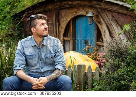 Young Caucasian Man Posing In Hobit Hole In Hobbiton, Lord Of The Rings And The Hobbit Films Movie S