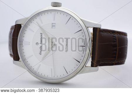 Geneve, Switzerland 01.10.2020 - Claude Bernard Swiss Made Mechanical Watch White Dial Leather Strap