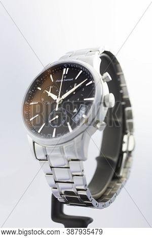 Geneve, Switzerland 01.10.2020 - Claude Bernard Man Swiss Made Watch Black Dial Metal Bracelet Isola