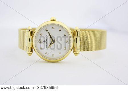 Geneve, Switzerland 01.10.2020 - Claude Bernard Woman Swiss Made Watch Gold Pvd Coating White Dial M