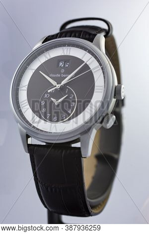 Geneve, Switzerland 01.10.2020 - Claude Bernard Man Swiss Made Watch Black Dial Leather Strap Isolat